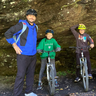 boys biking with dad